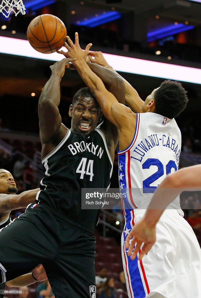 Andrew Nicholson #44 of the Brooklyn Nets has the ball knocked out of his hands by Timothe Luwawu-Cabarrot #20 of the Philadelphia 76ers in the second half during an NBA game at Wells Fargo Center on April 4, 2017 in Philadelphia, Pennsylvania.. The Nets defeated 76ers 141-118.
