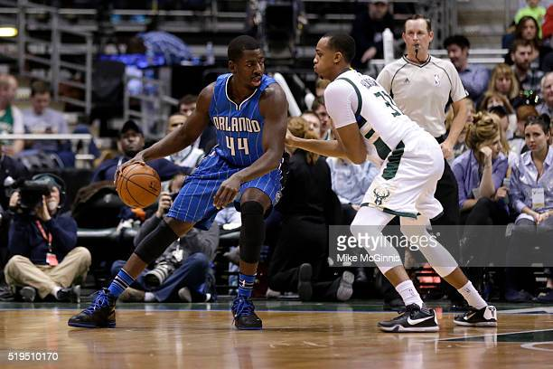 Andrew Nicholson of the Orlando Magic dribble the basketball during the first quarter against the Milwaukee Bucks at BMO Harris Bradley Center on...