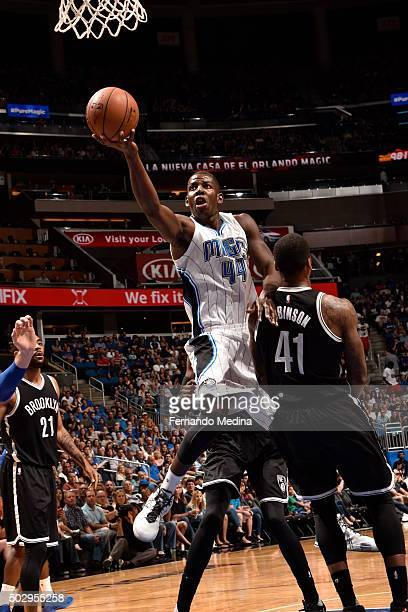 Andrew Nicholson of the Orlando Magic goes for the layup against Thomas Robinson of the Brooklyn Nets during the game on December 30 2015 at Amway...