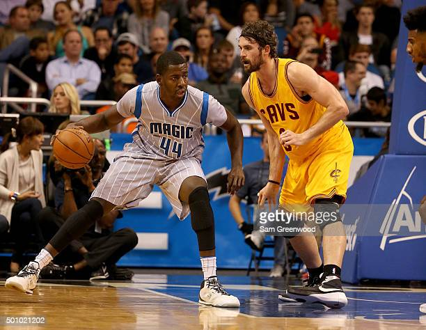Andrew Nicholson of the Orlando Magic is gaurded by Kevin Love of the Cleveland Cavaliers during the game at Amway Center on December 11 2015 in...