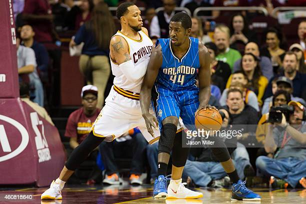 Andrew Nicholson of the Orlando Magic posts up against Shawn Marion of the Cleveland Cavaliers during the first half at Quicken Loans Arena on...