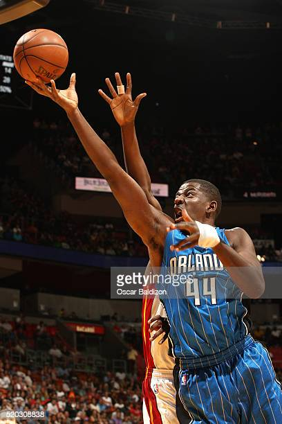 Andrew Nicholson of the Orlando Magic shoots a layup during the game against the Miami Heat on April 10 2016 at American Airlines Arena in Miami...
