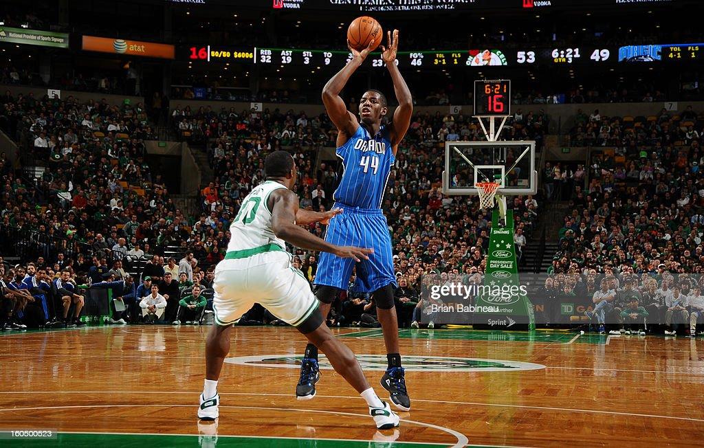 Andrew Nicholson #44 of the Orlando Magic shoots against Brandon Bass #30 of the Boston Celtics on February 1, 2013 at the TD Garden in Boston, Massachusetts.