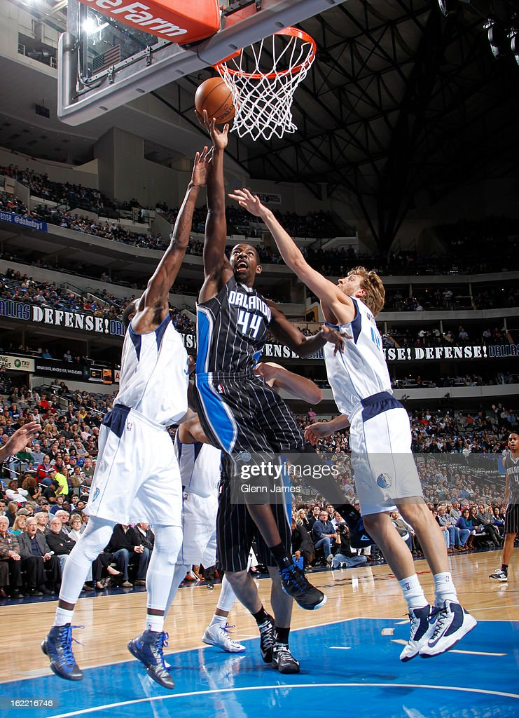 Andrew Nicholson #44 of the Orlando Magic shoots against Dirk Nowitzki #41 of the Dallas Mavericks on February 20, 2013 at the American Airlines Center in Dallas, Texas.