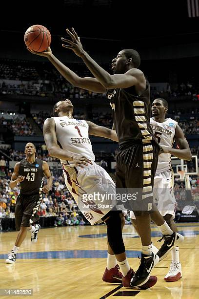 Andrew Nicholson of the St. Bonaventure Bonnies knocks down Xavier Gibson of the Florida State Seminoles during the second round of the 2012 NCAA...