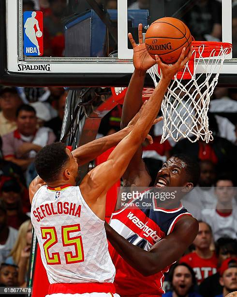Andrew Nicholson of the Washington Wizards defends the basket against Thabo Sefolosha of the Atlanta Hawks at Philips Arena on October 27 2016 in...