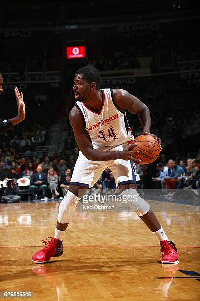 Andrew Nicholson of the Washington Wizards handles the ball against the Charlotte Hornets on December 14 2016 at Verizon Center in Washington DC NOTE...