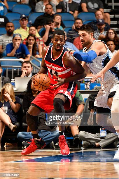 Andrew Nicholson of the Washington Wizards handles the ball during a game against the Orlando Magic on November 25 2016 at the Amway Center in...