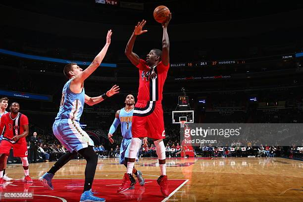 Andrew Nicholson of the Washington Wizards shoots the ball against the Denver Nuggets on December 8 2016 at Verizon Center in Washington DC NOTE TO...