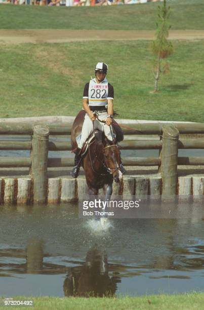 Andrew Nicholson pictured in action for the New Zealand team on his horse 'Kahlua' at the water hazard during competition to finish in 28th place in...