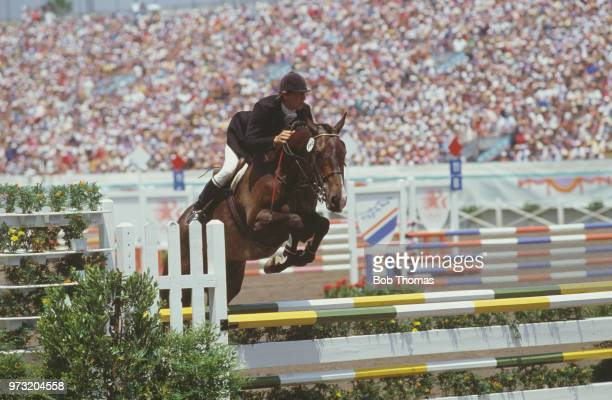Andrew Nicholson pictured in action for the New Zealand team on his horse 'Kahlua' during competition to finish in 28th place in the Mixed ThreeDay...