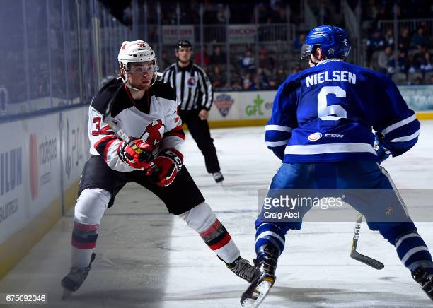 Andrew Nielsen of the Toronto Marlies puts Blake Speers of the Toronto Marlies in his scope during game 4 action in the Division Semifinal of the...