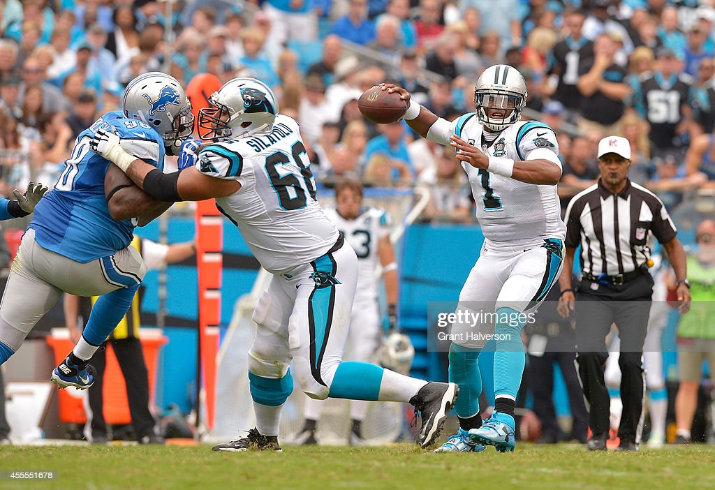 Andrew Norwell #68 of the Carolina Panthers blocks for teammate Cam Newton #1 during their game at Bank of America Stadium on September 14, 2014 in Charlotte, North Carolina. The Panthers won 24-7.