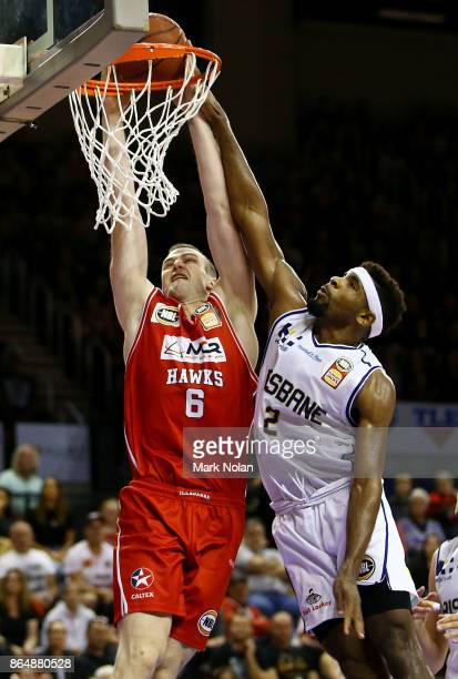 Andrew Ogilvy of the Hawks drives to the basket during the round three NBL match between the Illawarra Hawks and the Brisbane Bullets at Wollongong...