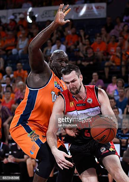 Andrew Ogilvy of the Hawks drives to the basket past Nathan Jawai of the Taipans during the round 16 NBL match between the Cairns Taipans and the...