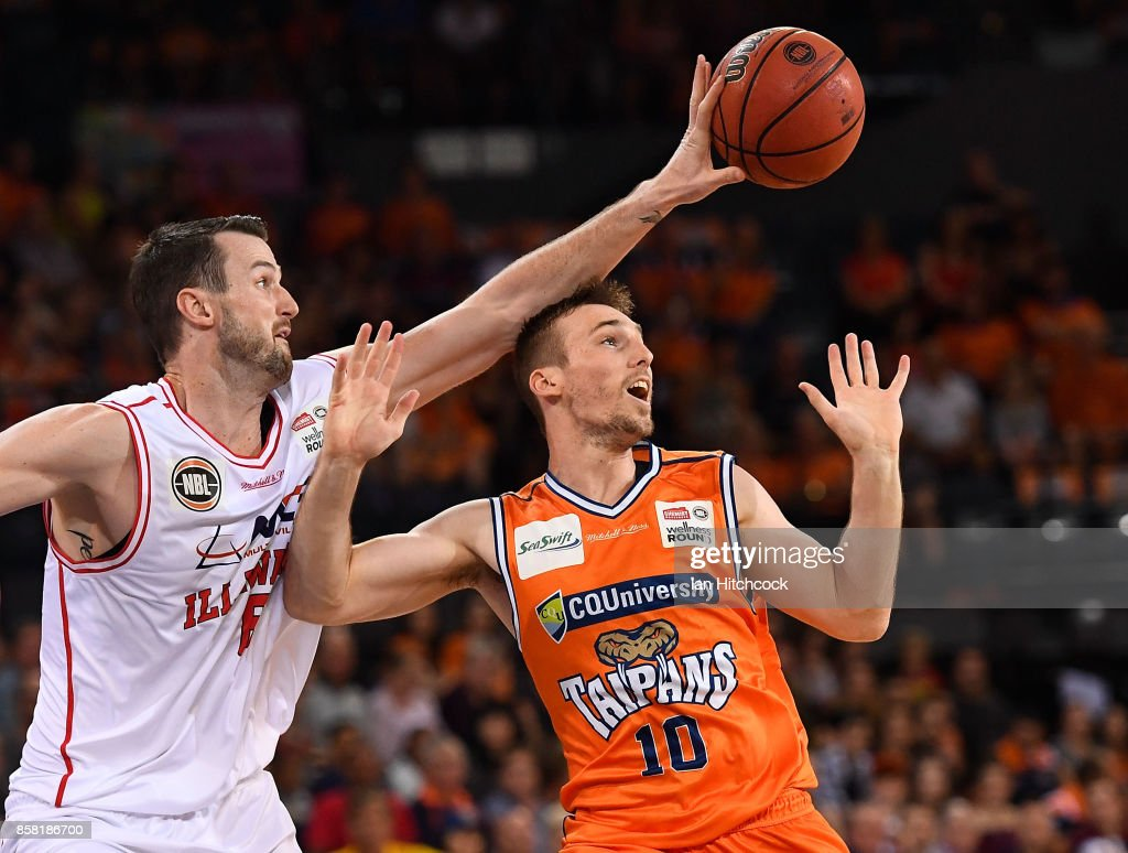 Andrew Ogilvy of the Hawks knocks the ball away from Mitch McCarron of the Taipans during the round one NBL match between the Cairns Taipans and the Illawarra Hawks at Cairns Convention Centre on October 6, 2017 in Cairns, Australia.