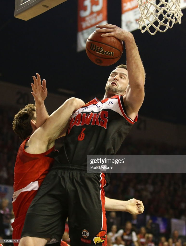 Andrew Ogilvy of the Hawks takes a rebound ahead of Angus Brandt of the WIldcats during game two of the NBL Grand Final series between the Perth Wildcats and the Illawarra Hawks at WIN Entertainment Centre on March 1, 2017 in Wollongong, Australia.