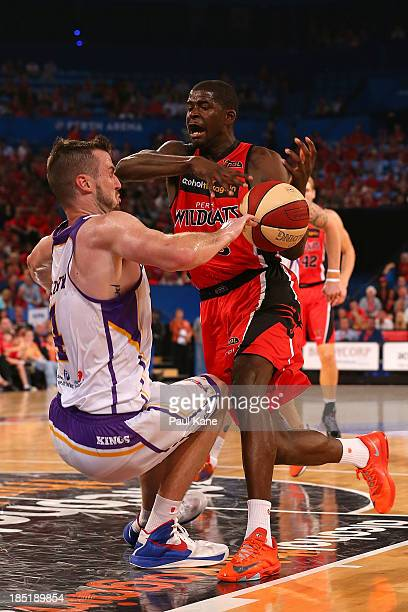Andrew Ogilvy of the Kings is fouled by James Ennis of the Wildcats during the round two NBL match between the Perth Wildcats and the Sydney Kings at...