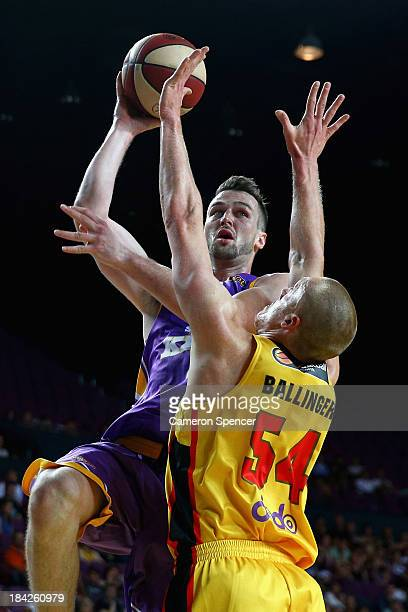 Andrew Ogilvy of the Kings lays the ball up during the round one NBL match between the Sydney Kings and the Melbourne Tigers at Sydney Entertainment...