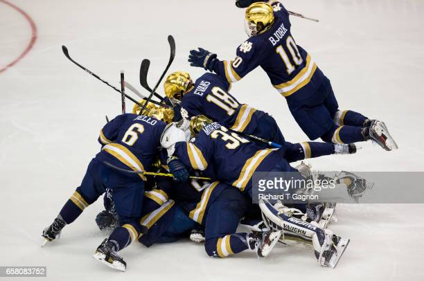 Andrew Oglevie of the Notre Dame Fighting Irish celebrates his overtime winning goal against the Massachusetts Lowell River Hawks during the NCAA...