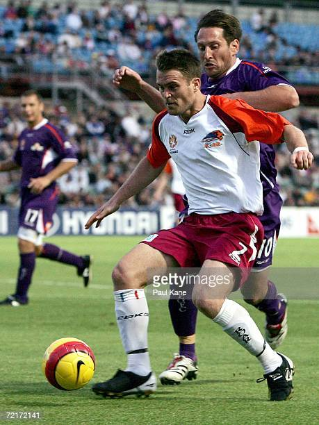 Andrew Packer of the Roar and Bobby Despotovski of the Glory contest the ball during the round eight Hyundai ALeague match between Perth Glory and...