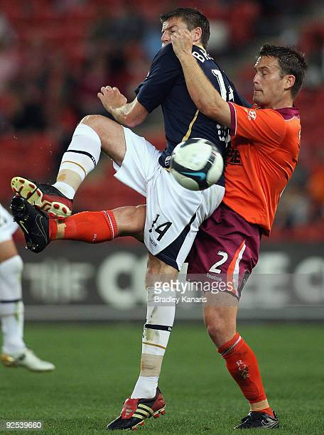 Andrew Packer of the Roar and Michael Bridges of the Jets challenge for the ball during the round 13 ALeague match between the Brisbane Roar and the...