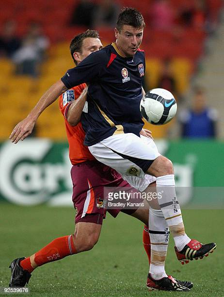 Andrew Packer of the Roar challenges Michael Bridges of the Jets during the round 13 ALeague match between the Brisbane Roar and the Newcastle Jets...