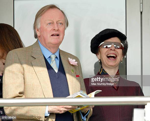 Andrew Parker Bowles and Princess Anne The Princess Royal watch the racing as they attend day 3 St Patrick's Day of the Cheltenham Festival on March...