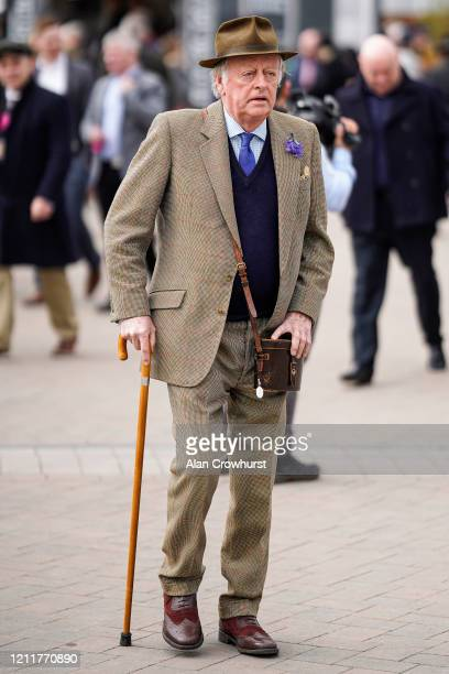 Andrew ParkerBowles arrives on Ladies Day at Cheltenham Racecourse on March 11 2020 in Cheltenham England