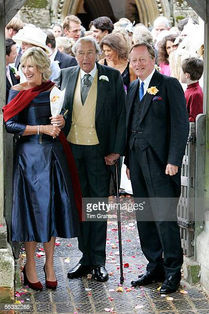 Andrew ParkerBowles father of the groom Bruce Shand grandfather of the groom and Annabel Elliott aunt of the groom attend the wedding of Tom...