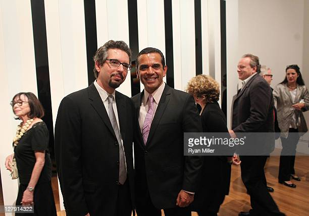 Andrew Perchuk, Deputy Director of the Getty Research Institute and Mayor Antonio Villaraigosa pose in fron of a Larry Bell installation during the...