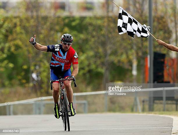 Andrew Perrin of Great Britain crosses the finish line to win the gold medal in the men's IRB3 race during the Road Cycling on Day Three of the...