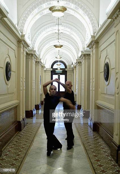 Andrew Pestel and Adrie Bass of the Netherlands practice in a corridor for the Mnes Latin competition at the Sydney 2002 Gay Games held in the Sydney...