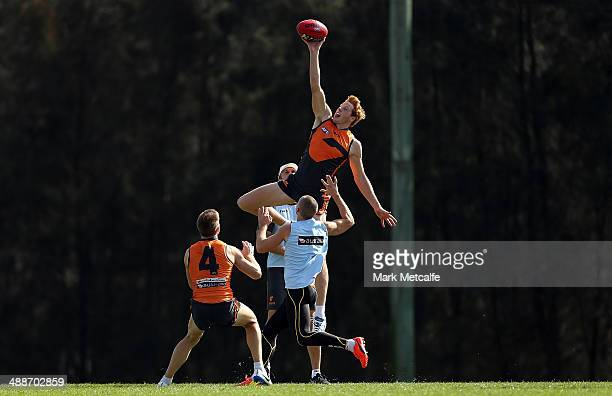 Andrew Phillips competes in the ruck during a Greater Western Sydney Giants AFL training session at Sydney Olympic Park Sports Centre on May 8 2014...