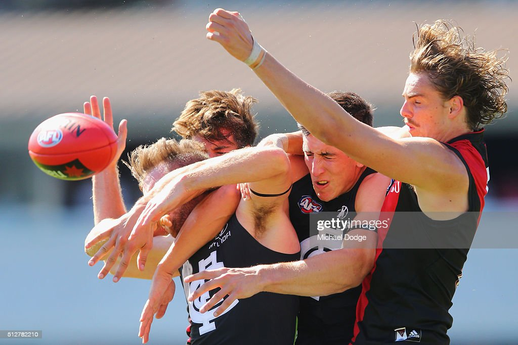 Andrew Phillips of the Blues (L) and Jacob Weitering of the Blues compete for the ball for Joe Daniher of the Bombers (R) during the 2016 AFL NAB Challenge match between Carlton and Essendon at Ikon Park on February 28, 2016 in Melbourne, Australia.