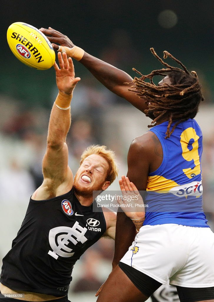 Andrew Phillips of the Blues and Nic Naitanui of the Eagles contest the ball during the round five AFL match between the Carlton Blues and the West Coast Eagles at Melbourne Cricket Ground on April 21, 2018 in Melbourne, Australia.