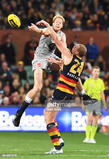 Andrew Phillips of the Blues competes for the ball against Sam Jacobs of the Adelaide Crows during the round seven AFL match between the Adelaide...