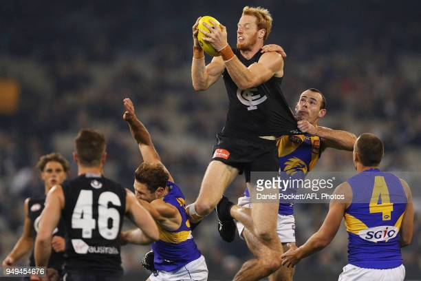 Andrew Phillips of the Blues marks the ball during the round five AFL match between the Carlton Blues and the West Coast Eagles at Melbourne Cricket...