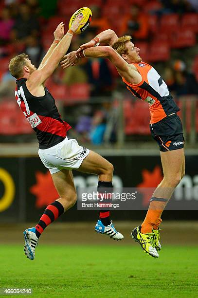 Andrew Phillips of the Giants and Jonathan Giles of the Bombers jump for a high ball during the NAB Challenge AFL match between the Greater Western...