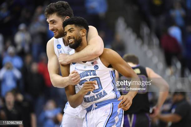 Andrew Platek and KJ Smith of the North Carolina Tar Heels celebrate their win over the the Washington Huskies in the second round of the 2019 NCAA...