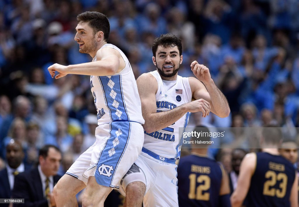 Andrew Platek #3 and Luke Maye #32 of the North Carolina Tar Heels react during a timeout during their game against the Notre Dame Fighting Irish at the Dean Smith Center on February 12, 2018 in Chapel Hill, North Carolina. North Carolina won 83-66.