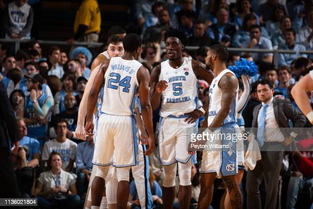 Andrew Platek Garrison Brooks Kenny Williams Nassir Little and Seventh Woods of the North Carolina Tar Heels huddle during a game against the Duke...