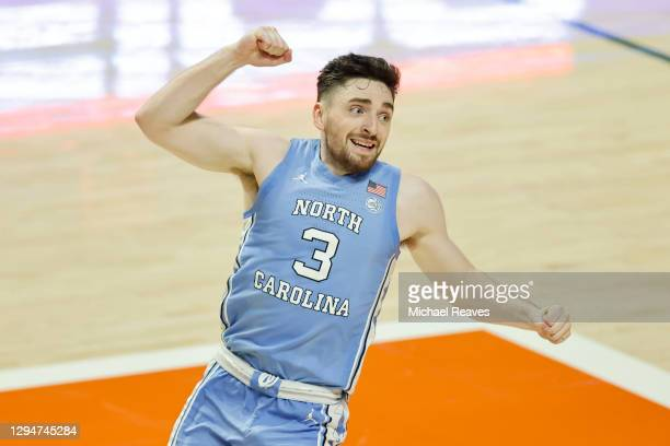 Andrew Platek of the North Carolina Tar Heels celebrates after making a game winning layup against the Miami Hurricanes with 3.6 second remaining...