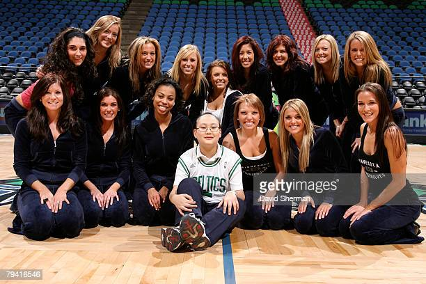 Andrew Poepping a MakeAWish recipient poses with the Minnesota Timberwolves dance team before the Timberwolves game against the Chicago Bulls on...