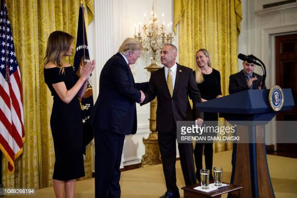 Andrew Pollack father of Stoneman Douglas High School mass shooting victim Meadow Pollack shakes hands with US President Donald Trump as US first...