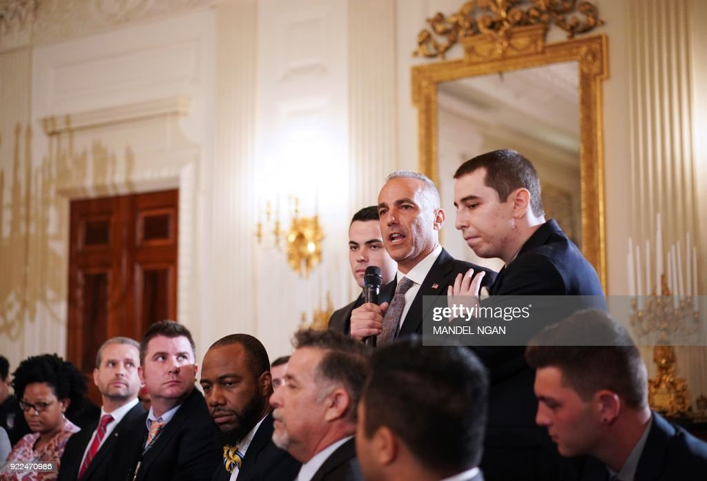 Andrew Pollack (C), flanked by his sons, speaks during listening session on gun violence with US President Donald Trump, teachers and students in the State Dining Room of the White House on February 21, 2018. Pollack's daughter Meadow was killed in the Marjory Stoneman Douglas High School shooting in Parkland, Florida. /