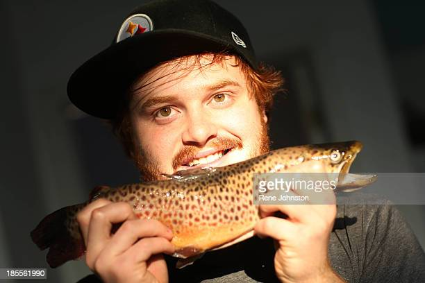 Andrew Poulsen of Hooked fish shop cooks a whole brown trout Toronto October 21 2013 TORONTO ON OCTOBER 21 Andrew Poulsen of Hooked fish shop cooks a...