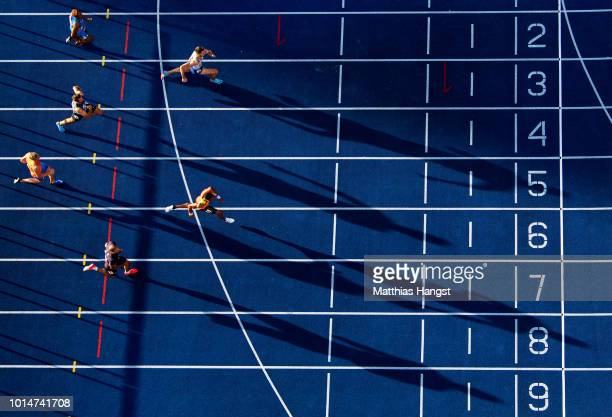 Andrew Pozzi of Great Britain and Koen Smet of The Netherlands compete in the Men's 110 metres hurdles heats during day four of the 24th European...