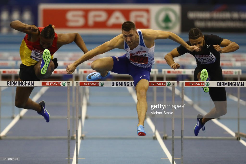 Andrew Pozzi (C) of Stratford-Upon-Avon clears the last hurdle to win the final of the 60m hurdles during day one of the SPAR British Athletics Indoor Championships at Arena Birmingham on February 17, 2018 in Birmingham, England.