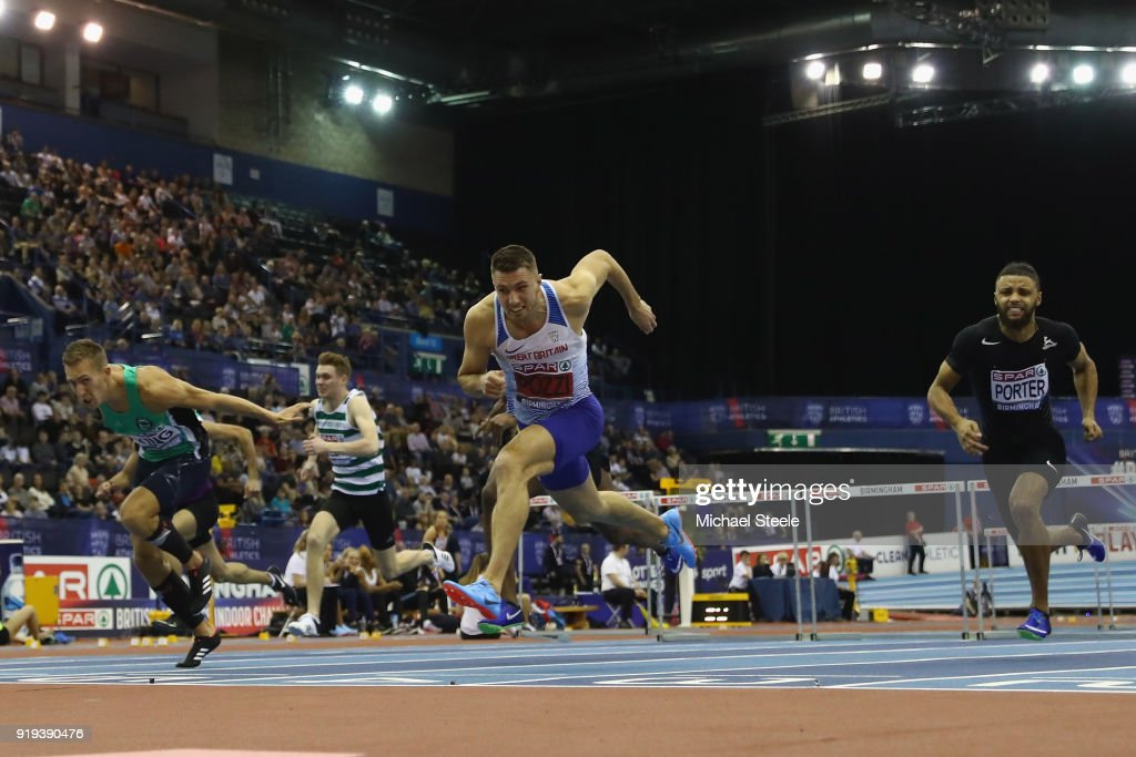 Andrew Pozzi (2R) of Stratford-Upon-Avon dips for the line to win the final of the 60m hurdles during day one of the SPAR British Athletics Indoor Championships at Arena Birmingham on February 17, 2018 in Birmingham, England.